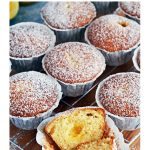 Easy Lemon Curd Muffins on a wire rack and wooden board