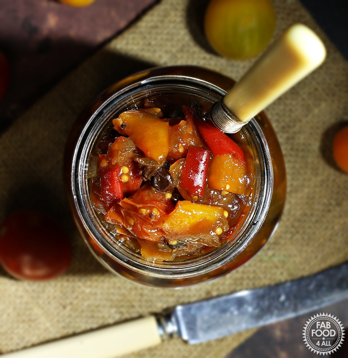 Spicy Baby Tomato & Sweet Pepper Chutney in a jar with fork in it.