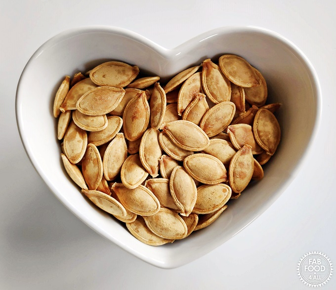 Roasted Pumpkin Seeds in a heart shaped dish.