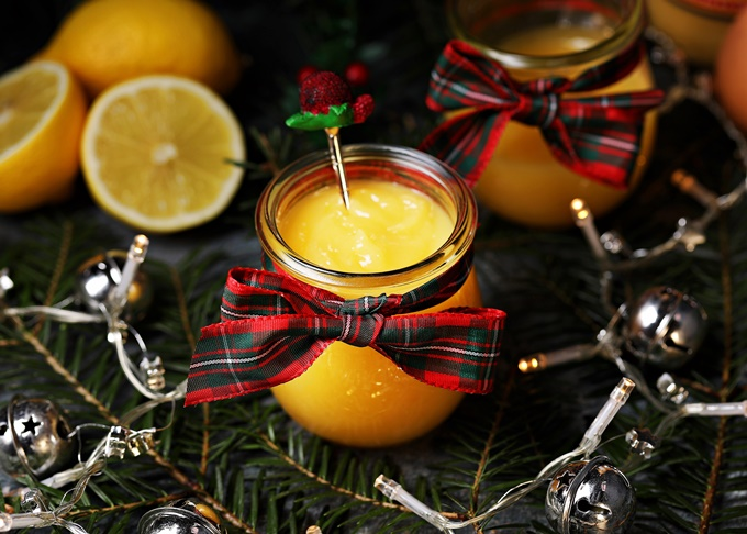 Advocaat Curd with teaspoon, lemons, Christmas tree branches & fairy lights.