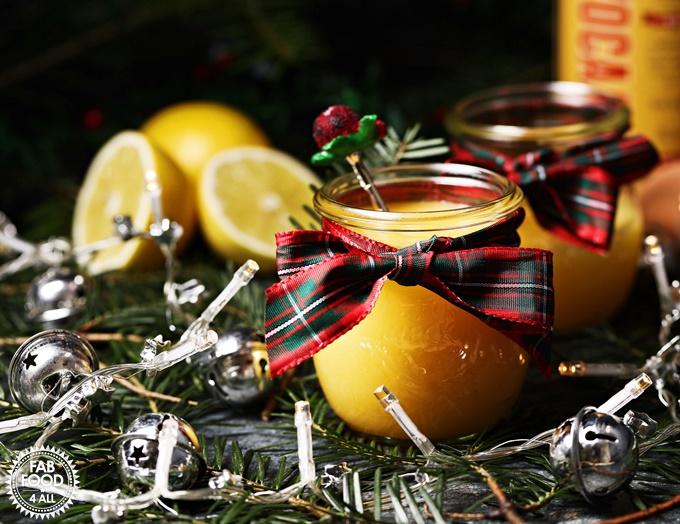 Snowball Curd with teaspoon, lemons, Christmas tree branches & fairy lights.