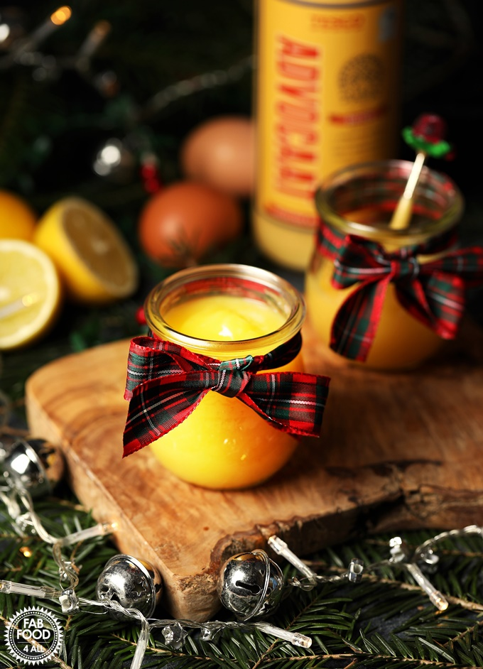 Snowball (Eggnog) Curd in a jar with lemon, eggs & Advocaat in background.