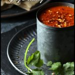 5 Minute Vegan Tomato Soup in a tin mug on tin plate with cut flatbread. Pin image.