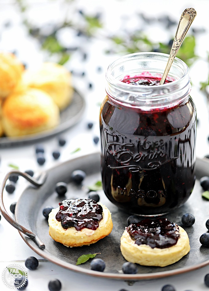 Sloe & Apple Jam in a jar on plate with scones.