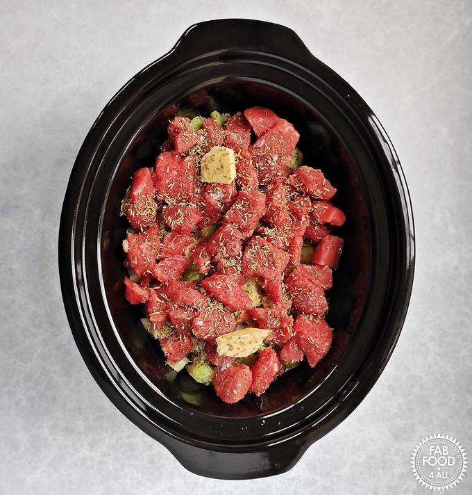 Vegetables & stewing beef in slow cooker (raw ingredients).