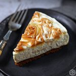 Slice of Easy No Bake Salted Caramel Cheesecake on a plate with fork.