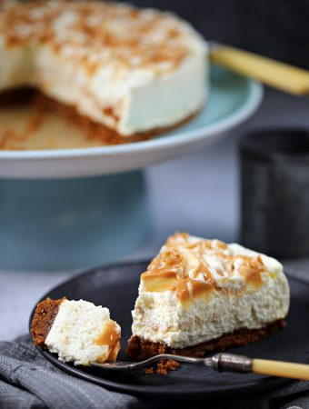 Salted Caramel Cheesecake (no-bake) with cut slice with forkful on a plate.