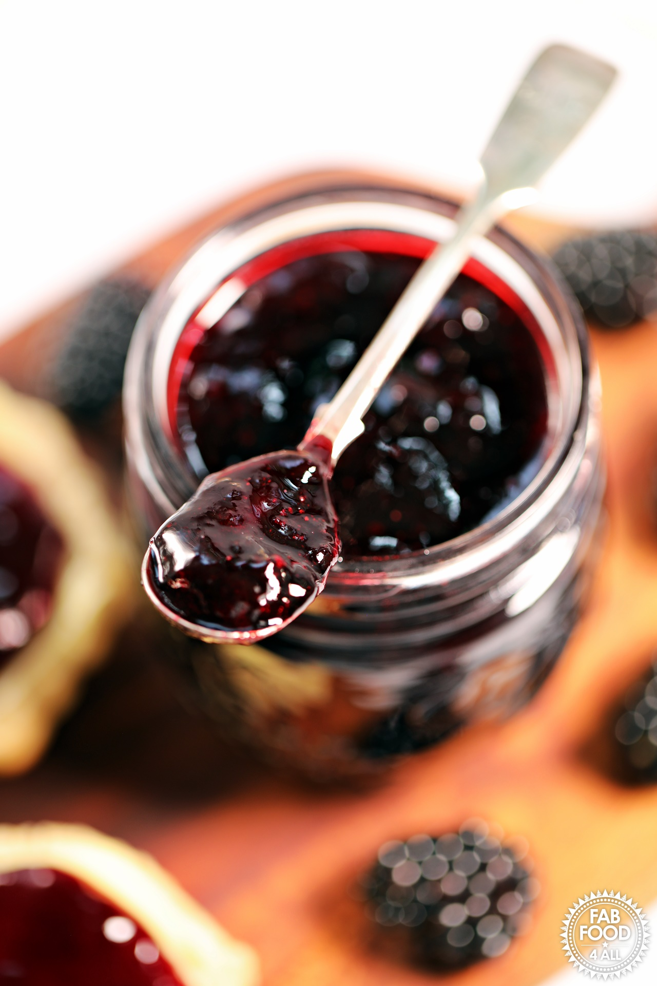 Easy Seedless Blackberry Jam with scone, close up.